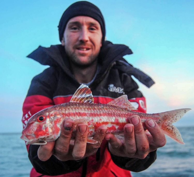 Local angler Daniel Tulip with a rare red mullet