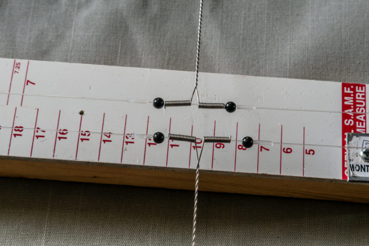 Wire booms located using glued stops