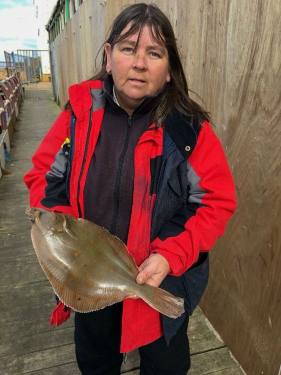 Tracey Howarth with a 2lb plus North Pier plaice