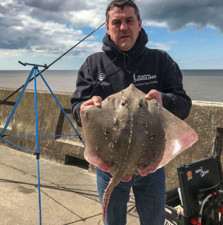 Mark Thompson of the Lancashire Sea Fishing group with an 8lb ray