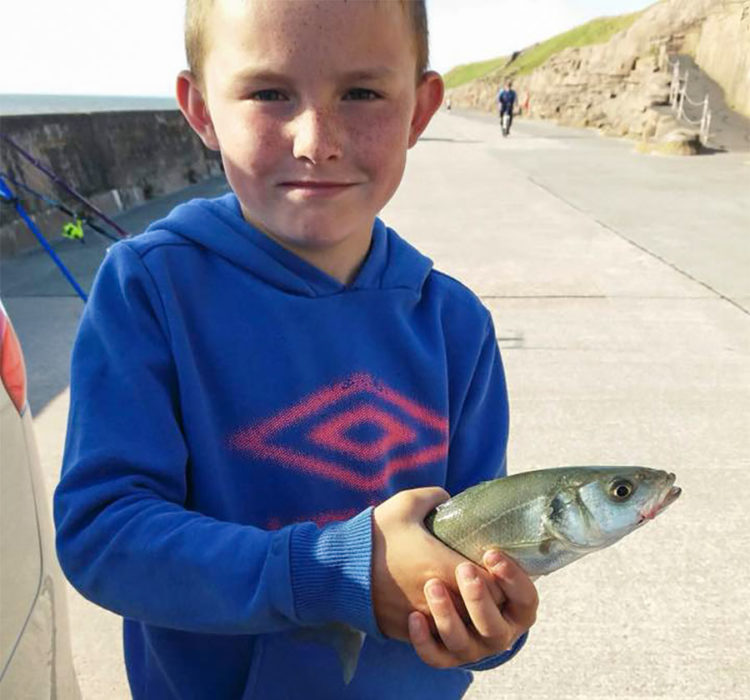 Eight year old Liam Vitner with his first ever fish