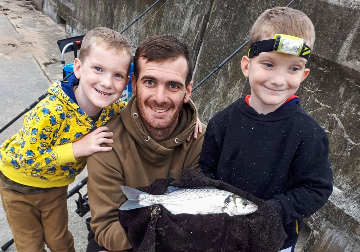 Nathan Pickering with sons Ollie, Jacob and a Gynn Wall bass