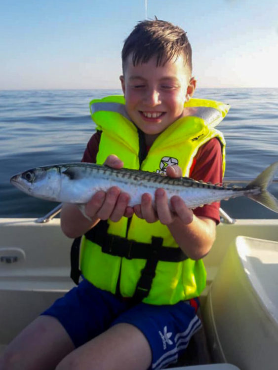 10 year old Tyler Barlow with a nice mackerel